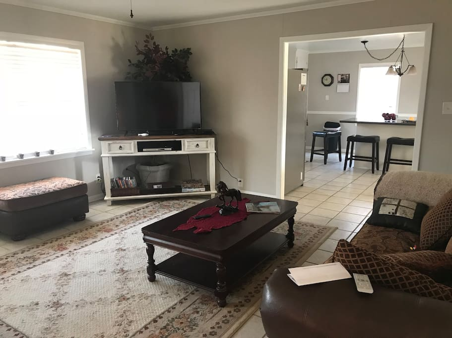 Spacious living room with a big screen television, Directv, and lots of DVDs.