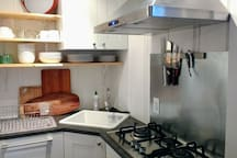 Fully stocked kitchen has most appliances and tools you will need.