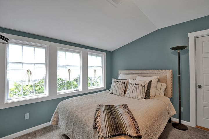 Beautiful, light-filled third bedroom with a queen bed, ready for rest.
