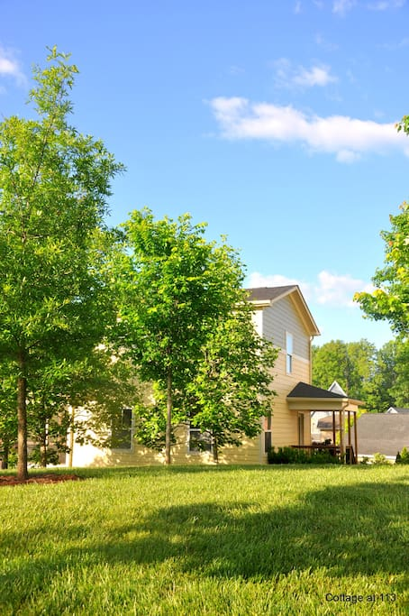 Corner lot with green space offers a quiet, private feel