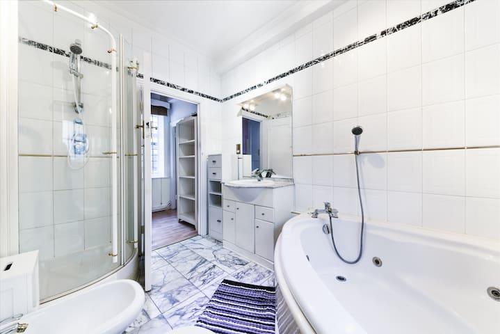 Bathroom with shower and big bathtub