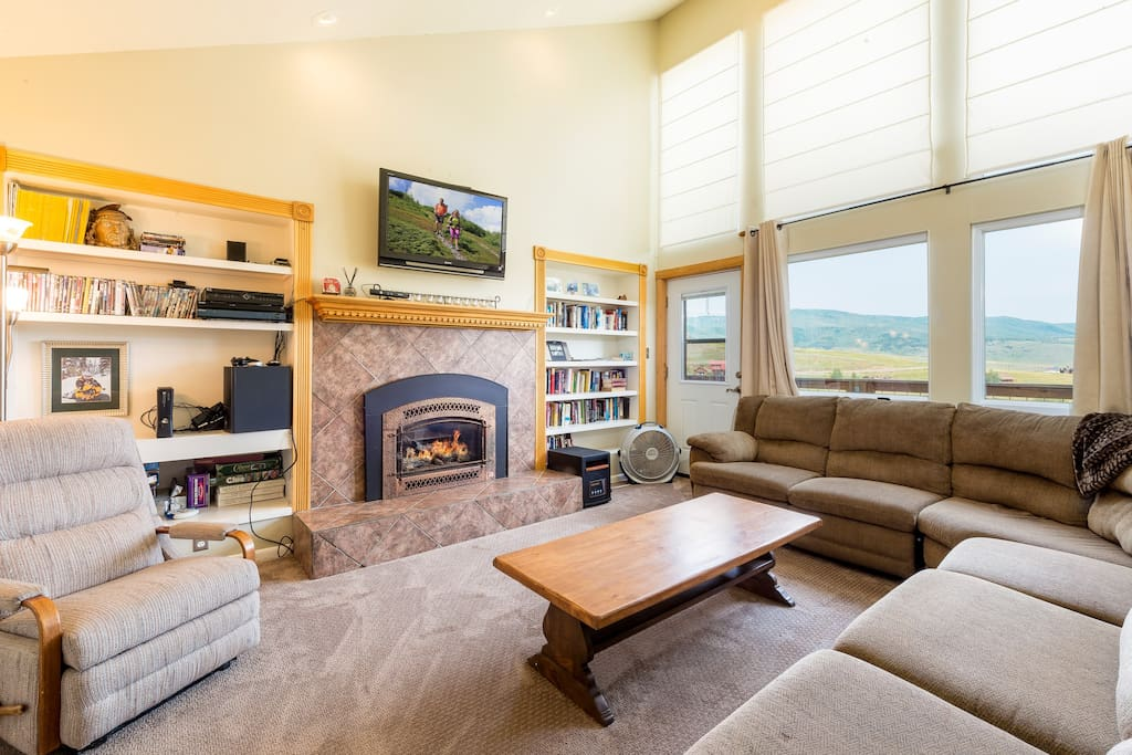 "A 42"" Sony flat screen TV sits above a gas fireplace in the living room."