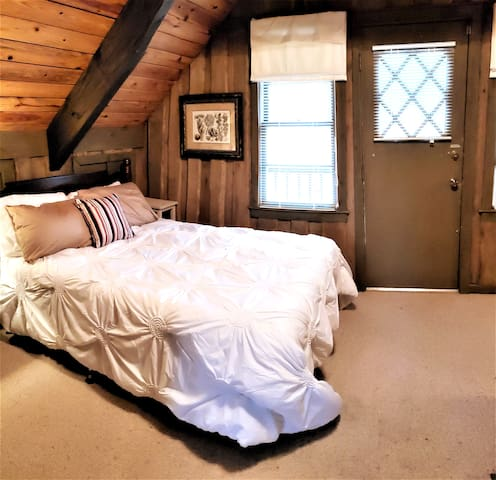Upstairs second bedroom with a queen bed and it's own porch.
