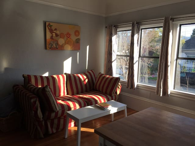 Bright front room with comfy full sized sofa-bed