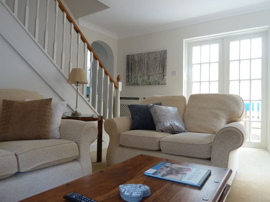 Comfortable Lounge with doors to conservatory dining room, log burner and Smart TV with Netflix