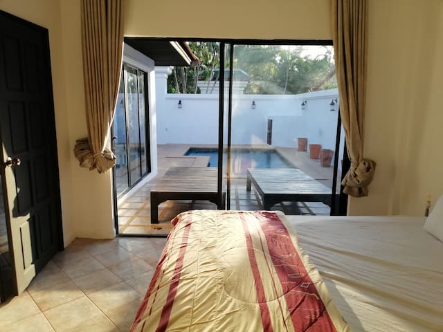 Bedroom opens up to the pool through the large sliding glass doors