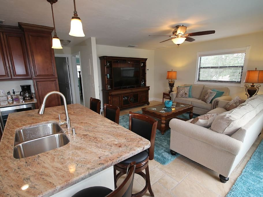 "Very open layout. New sleeper sofa set, new barstools & a large 55"" LED tv too."