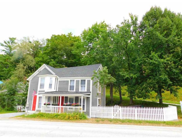 The second oldest home in Londonderry, nestled right in the village. The house is from the early 1800's and has tons of old Vermont charm including wavy floors. The picket fence is a great buffer from the road and provides a nice little yard for grilling and walking dogs safely. There is driveway parking, and a large parking lot for additional parking across the street.