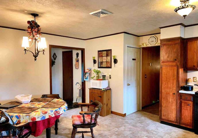 The kitchen and dining room is one room located between the living room and a hallway to the bedrooms and the bathroom. The dining table can seat six comfortably. The back entrance is also located from the kitchen. You will have a key for the door.