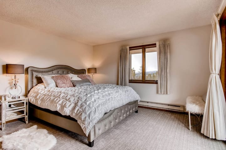 Large primary bedroom with en suite bath and king bed