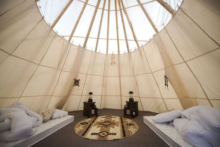 Sleep in a tipi at Mt Rainier for 4  by the river