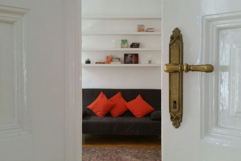 Master bedroom from the living room - beautifully renovated wooden door and handle