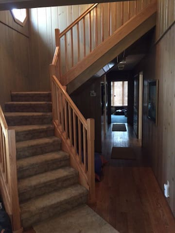 Entryway, stairs to master suite, hallway to main-level bedrooms and bathroom.