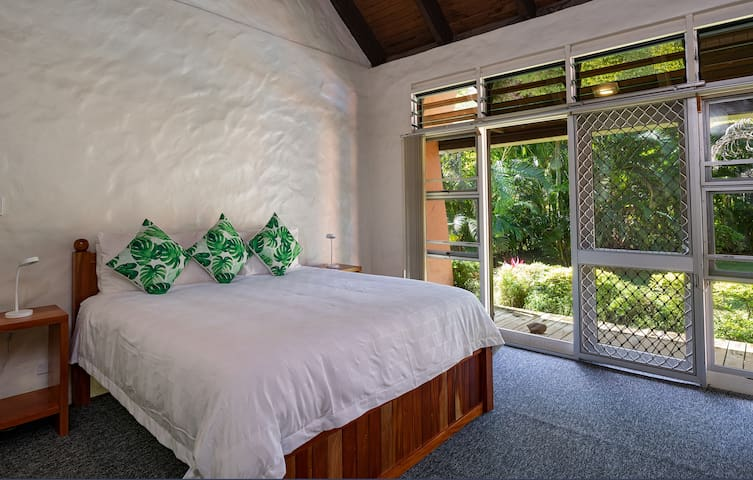 Master bedroom with private ensuite and access to the pool and deck.