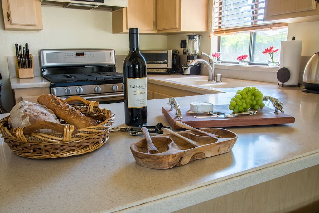 The kitchen bar is the perfect spot for --what else?--wine and cheese!