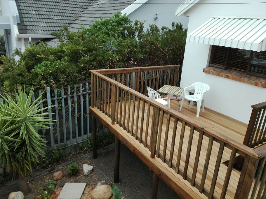The wooden deck overlooks pretty garden with Aloes and Yuccas.
