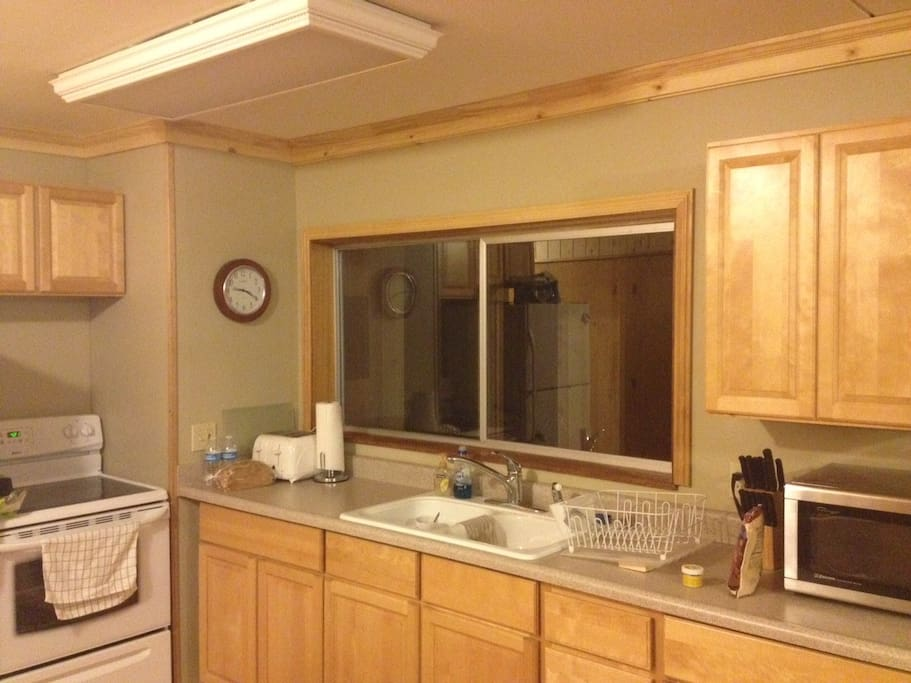 Full kitchen with dishes and appliances