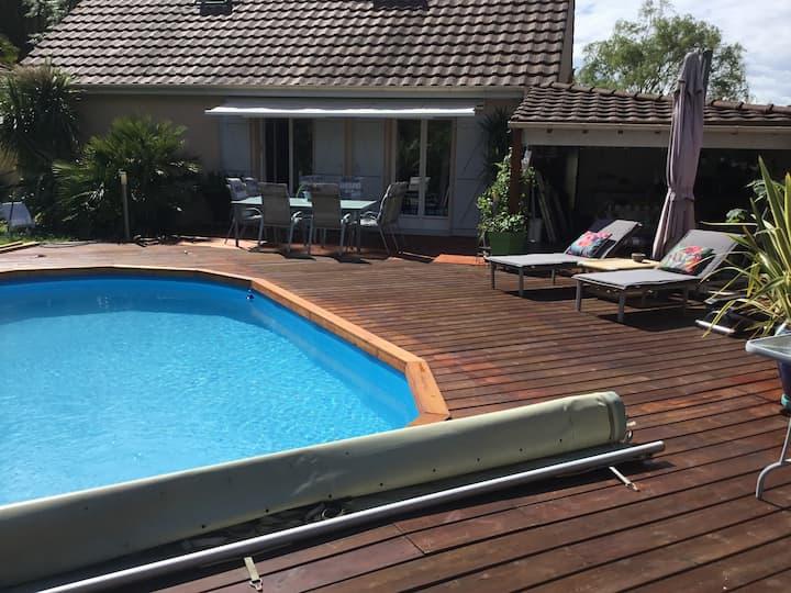 Maison avec piscine chauffée