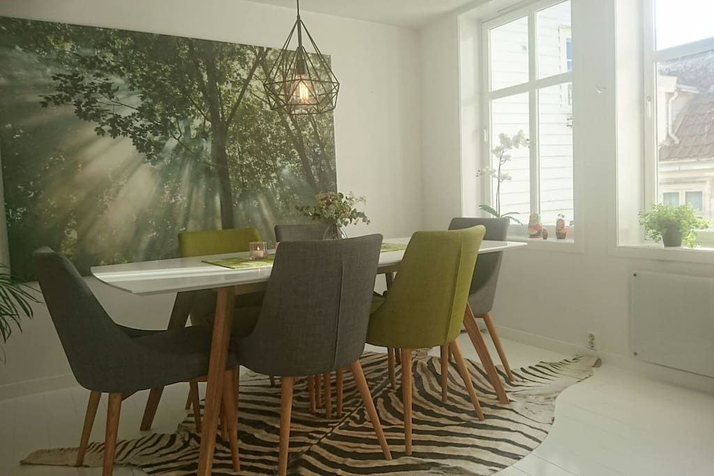 Dining room with 6 comfy chairs.