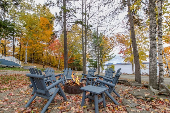 Hillside lakefront home with dock, snowmobile trails, & free WiFi - Dogs OK!
