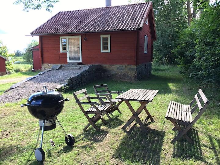 Timmerstuga utanför Växjö