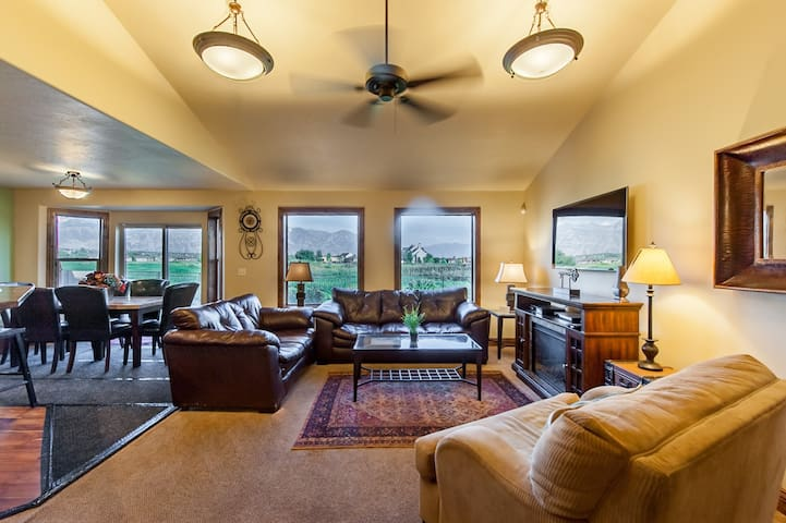 """Upstairs living area - spectacular views of """"Y Mountain"""""""