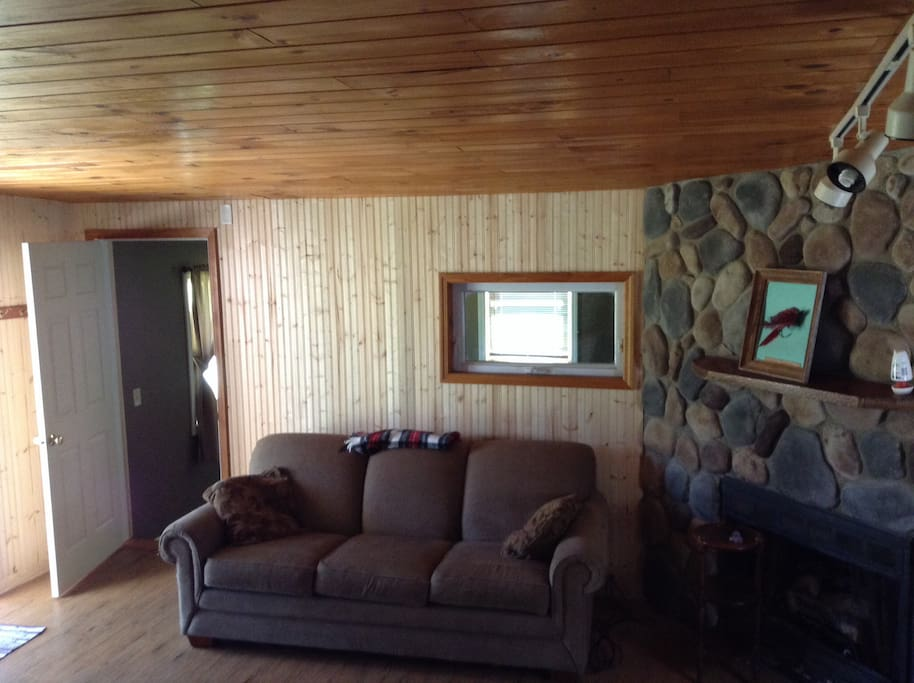 Living room addition with queen sleeper  and sliding glass door