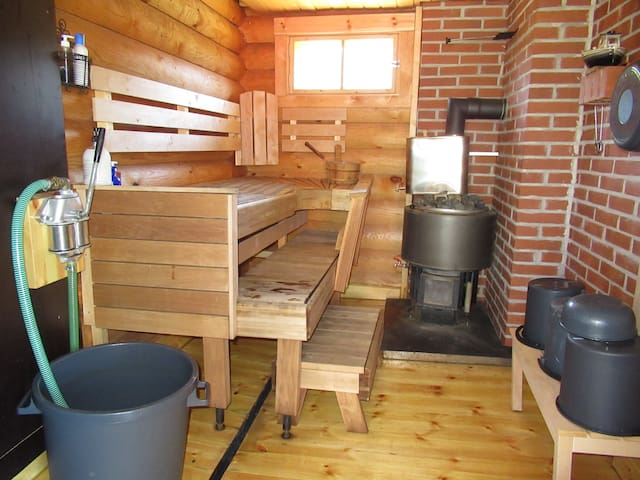 Sauna, stove wood heating. 30+30 liter hot water containers. Electric water pump + hand pump.