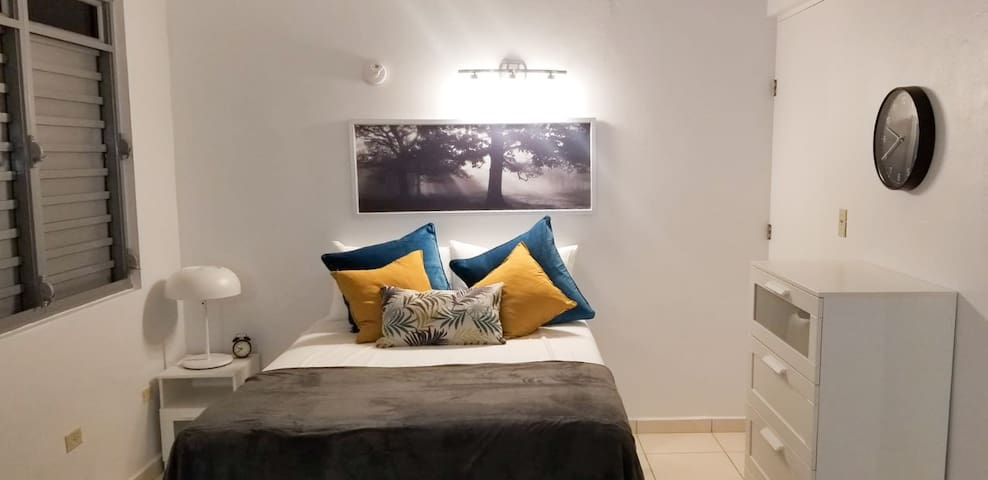 Spacious 1 Bedroom equipped with a  Queen Size Bed, dresser and small nook overlooking the beach.