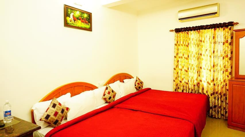 Triple Budget Room at Thayamkerys Royal Inn Market Road Edappally Kochi Kerala