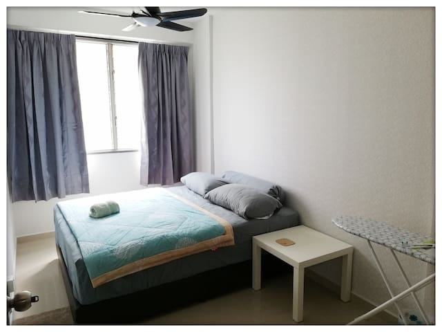 [Masterbedroom] Queen size bed, a ceiling fan, a clothes hanger, small table, ironing board, iron and hair dryer.
