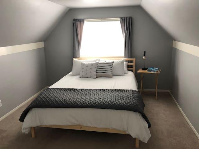 Upstairs master bedroom. Comfortable Queen bed.