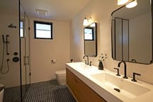 Guest bath with double sink, soaking tub and glass enclosed shower