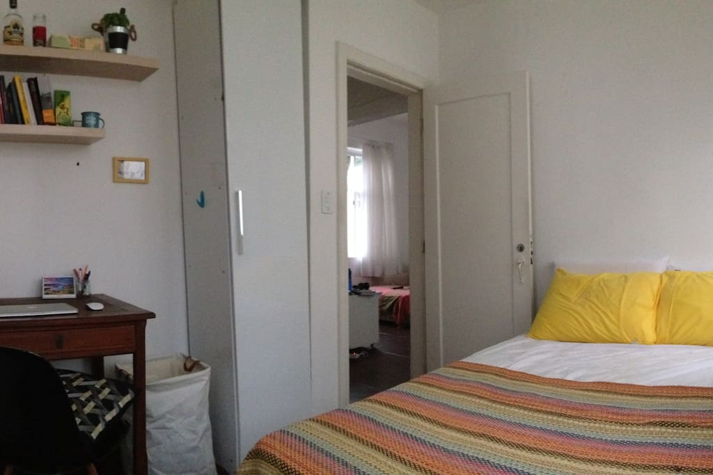 Room with spacious bed, desk and wardrobe