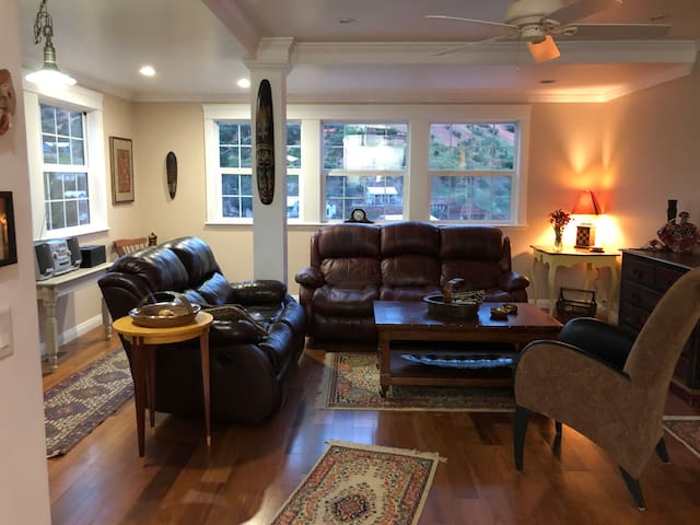"""Livingroom, overlooking Brewery Gulch, and view of """"B"""" Mountain.  Reclining leather sofas."""