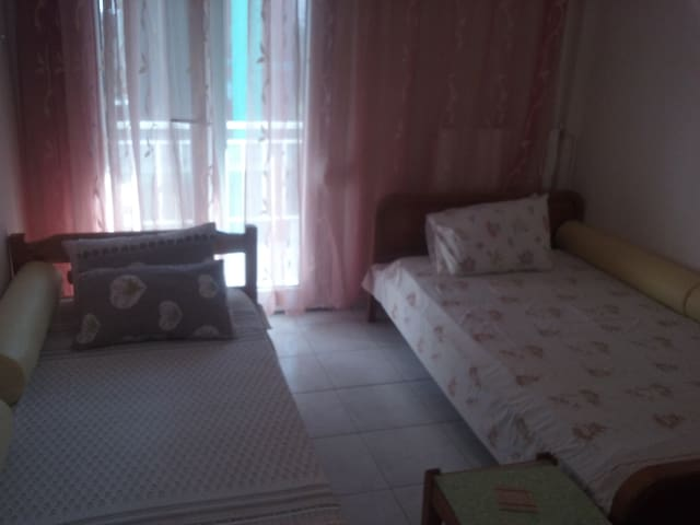 In the second room there are 2 beds, television and a small round table