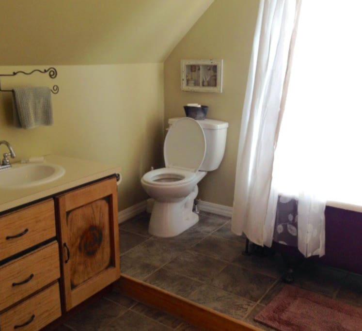 Clawfoot tub in shared bathroom.