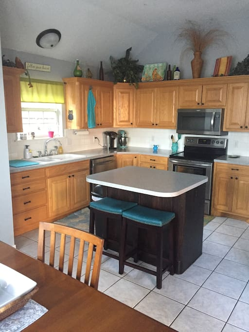 Eat in kitchen with large fridge and extra seating. Keurig available as well.