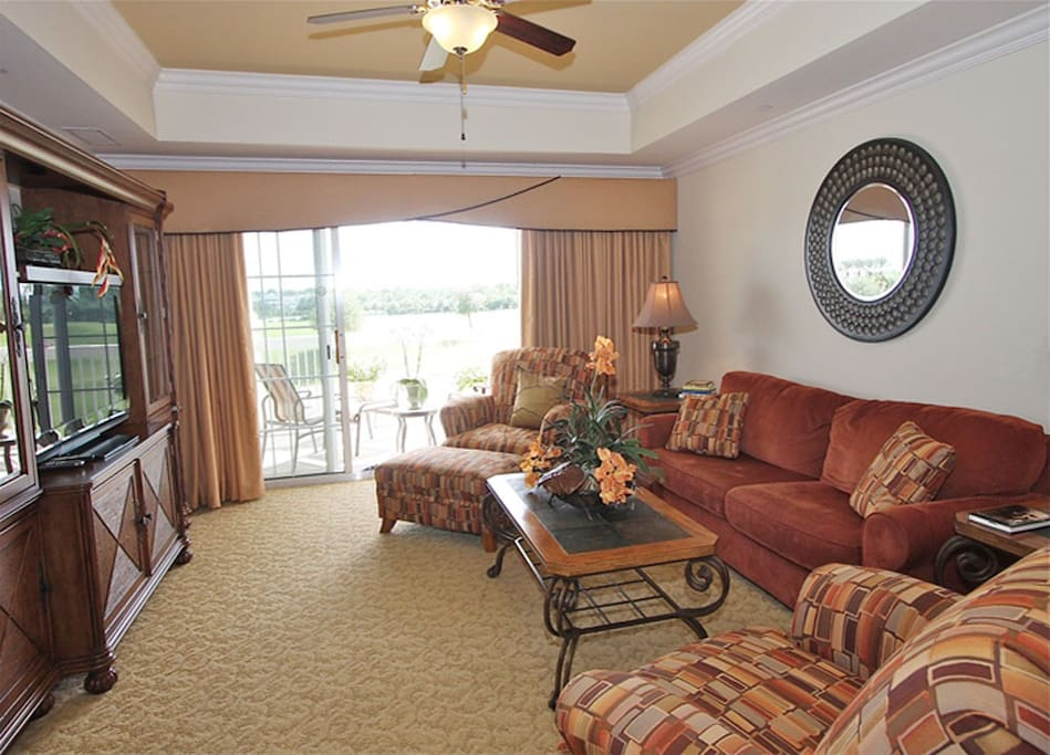 Living room with access onto private south-facing balcony.