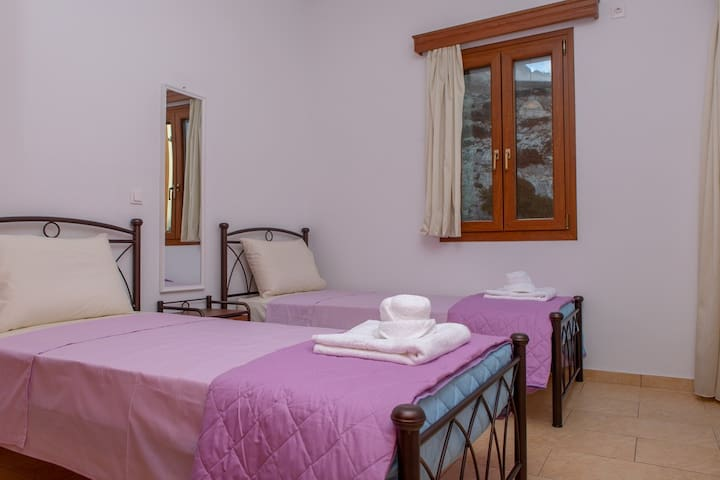 Bedroom with two single beds, large wardrobe ,a bed-table, wonderful view and very large balcony.
