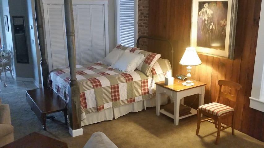 Queen Bed with rustic headboard
