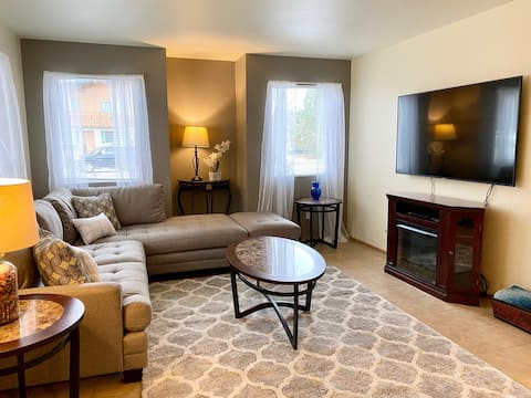 """New sectional sofa with a 65"""" Smart TV connected to Netflix"""