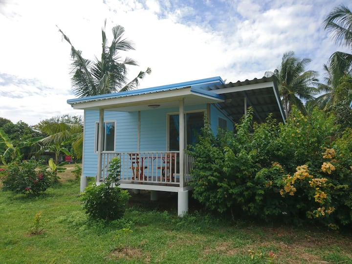 New house with AC and kitchen close to beach.