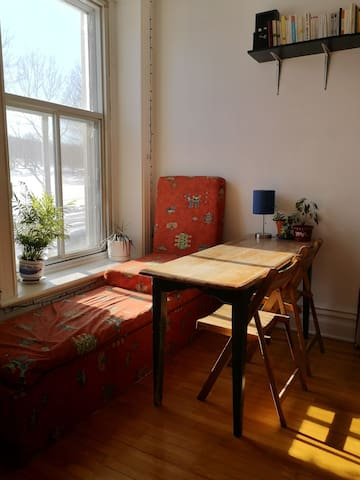 dining table, also a great bench to read comfortably in front of the window
