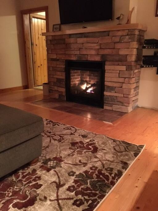 Welcoming propane fireplace with flat screen TV above - LR