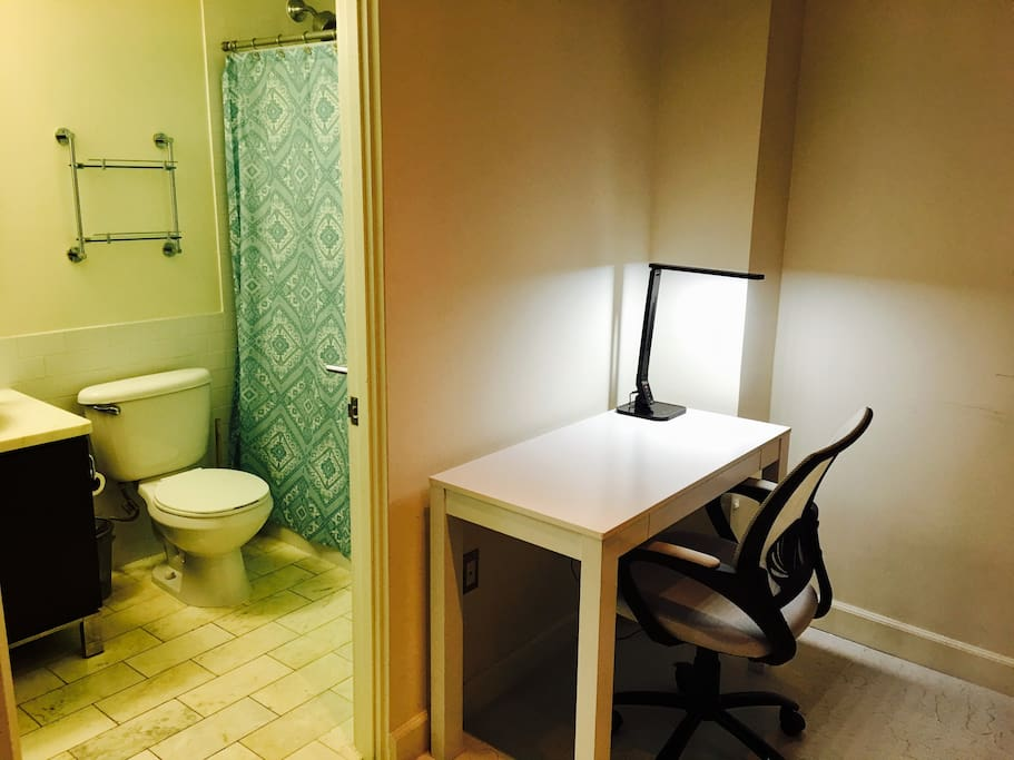 Actual listing room desk with private attached bathroom.