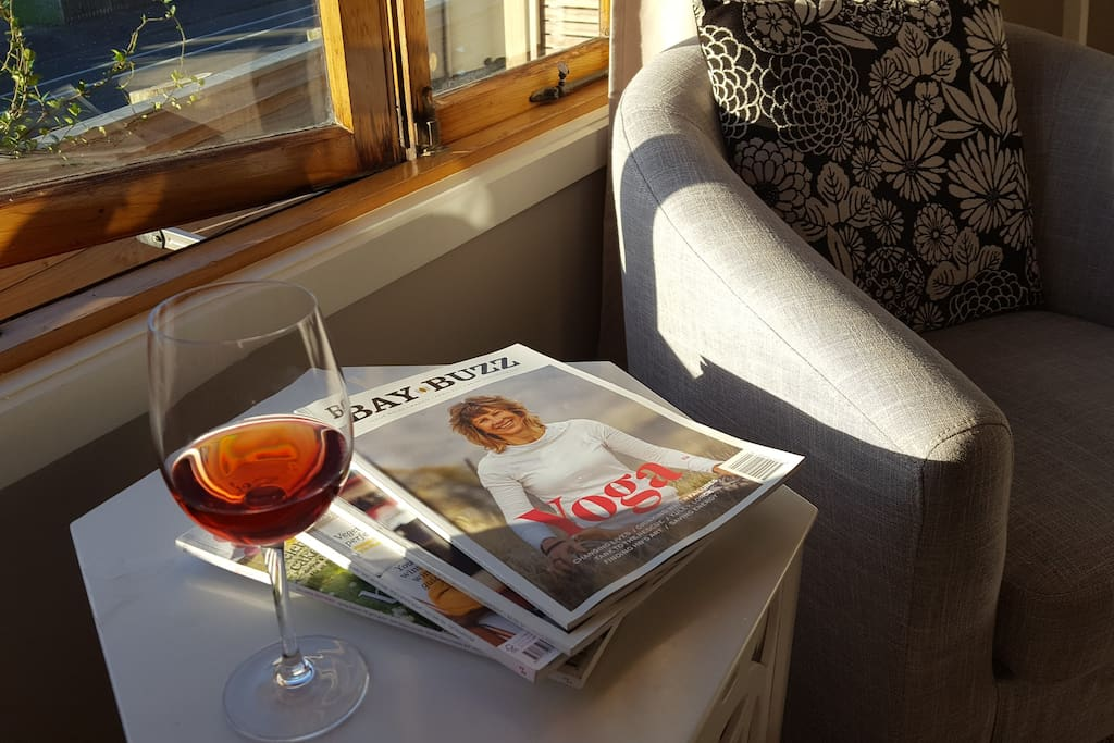 Enjoy the sunlit lounging area with a wine and mag.