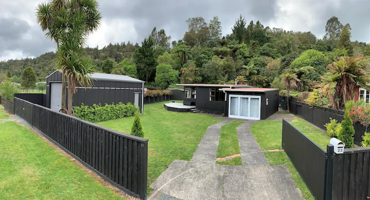 Lake house set among native NZ bush and birdlife