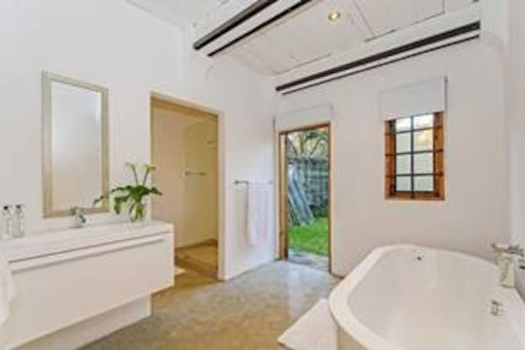 En suite bathroom with bath and shower