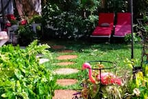 Each path way you will discover your favorite charming space... Please  enjoy your barbecue, or swing, or 3 table & many launge chairs.